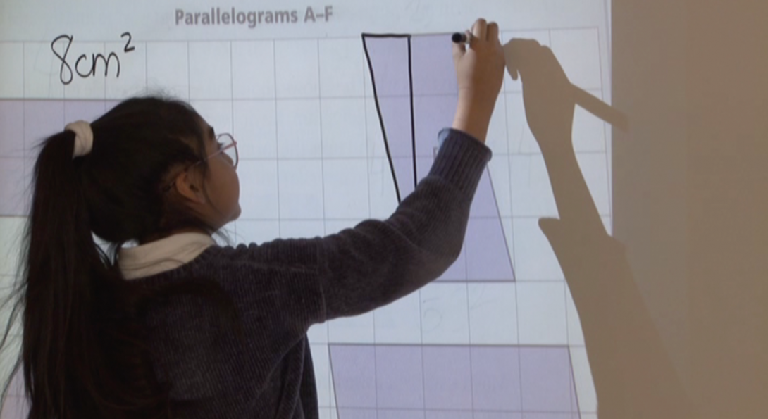 Student working on the board